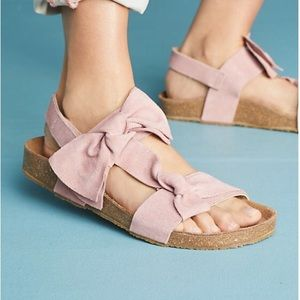 Pink bow sandals.